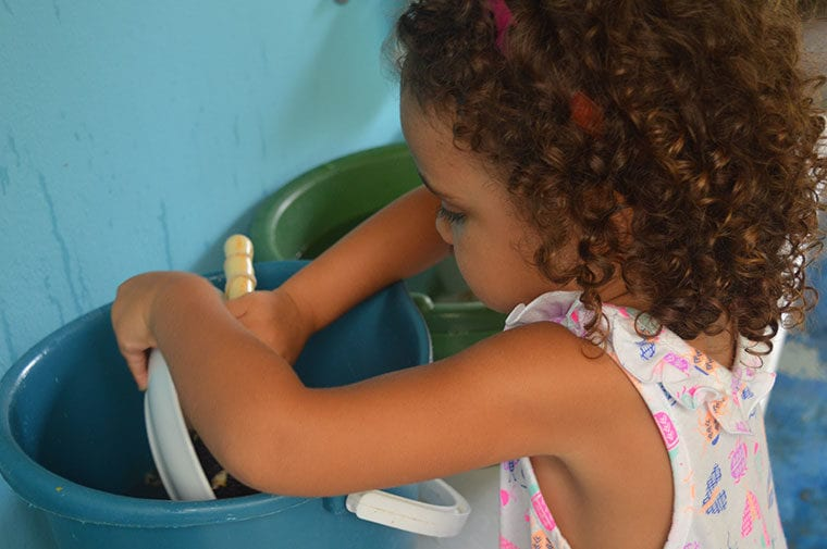 Child washing their dishes
